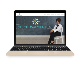 The Intentional Wellness Group on a gold Macbook Air